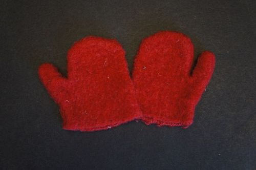 Very small child's first mittens, red wool hand sewn