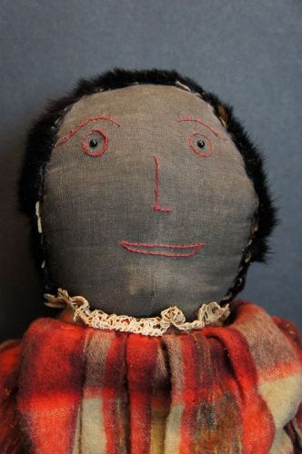 Antique black cloth doll embroidered face, pelt hair