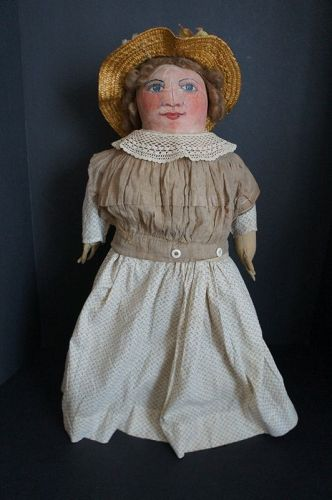 Painted face antique clot doll with big blue eyes, rosy cheeks 20""