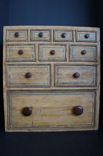 Small multi drawer chest in original mustard paint striped with blue