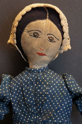 Quiet beauty a 19th C. homemade doll with exquisite embroidered face