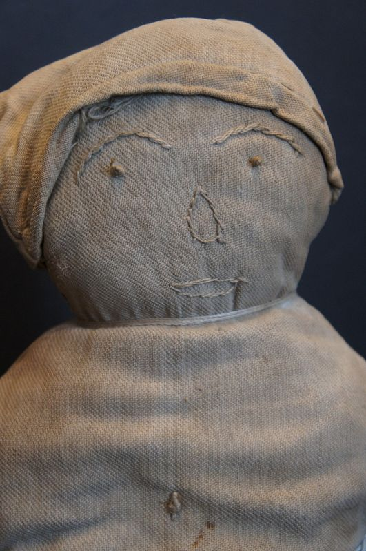 A little sweet tuffy, happy embroidered face doll striped pants C.1900