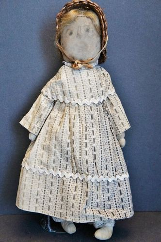 "A sweet little ""Petunia"" cloth doll with a pencil face 14"" circa 1890"