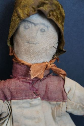 Wonderful early pencil face stump doll in orig clothes