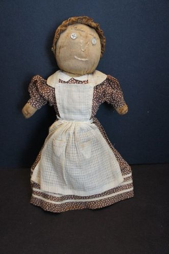 C. 1900 stockinette stump doll with brown calico dress. 14""