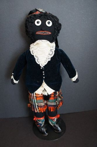 A great Golliwog from the early 1900's dressed in a Scottish Kilt