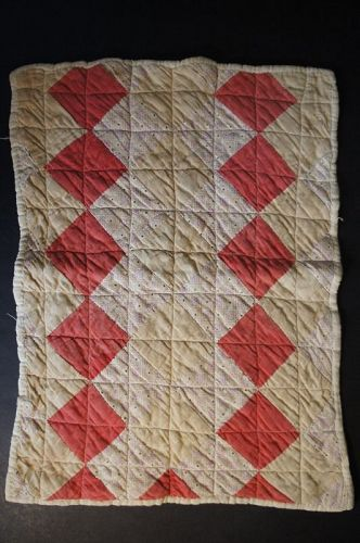 Antique doll quilt hand pieced in red, tan and beige calico material