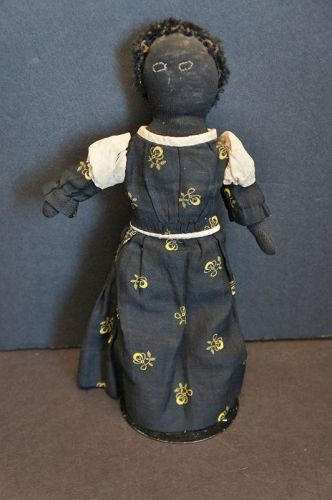 "A darling  10"" stockinette doll with calico dress and astrakhan hair"