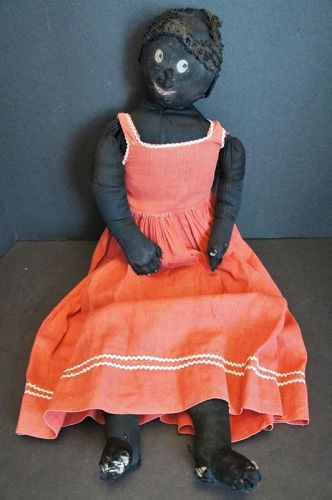 A little bit flirty black cloth doll in her favorite red dress 24""
