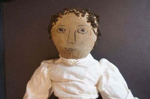 "20"" cloth doll with a boldly drawn ink face, early yarn hair C1880"