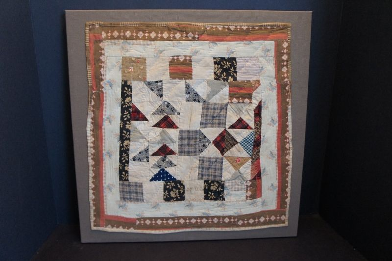 """1850-60 brown and red doll quilt 15"""" by 17"""" newly mounted"""