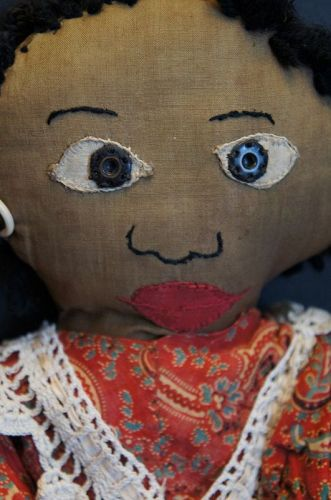 Sweet little black doll that has early snaps for eye and fancy legs