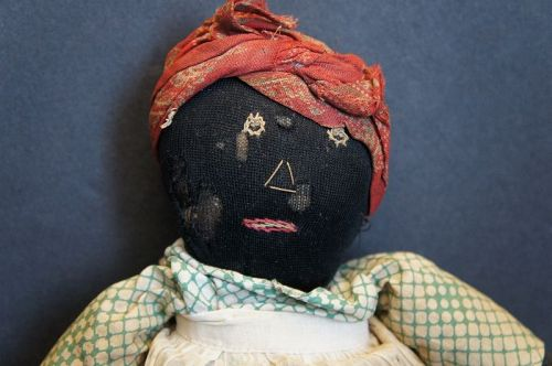 "A dear little black doll with nicely embroidered features 11"" C. 1920"
