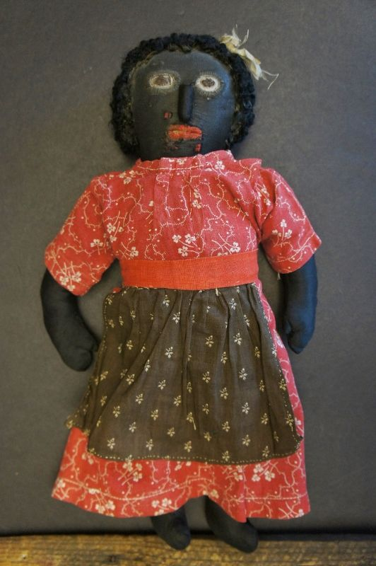 19th C. Black cloth doll with an amazing face, astrakhan hair 13""