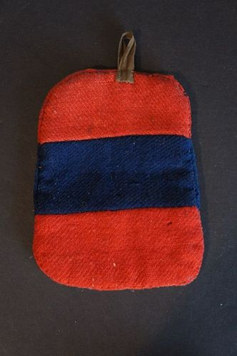A folky red and blue homespun Pennsylvania potholder Circa 1840