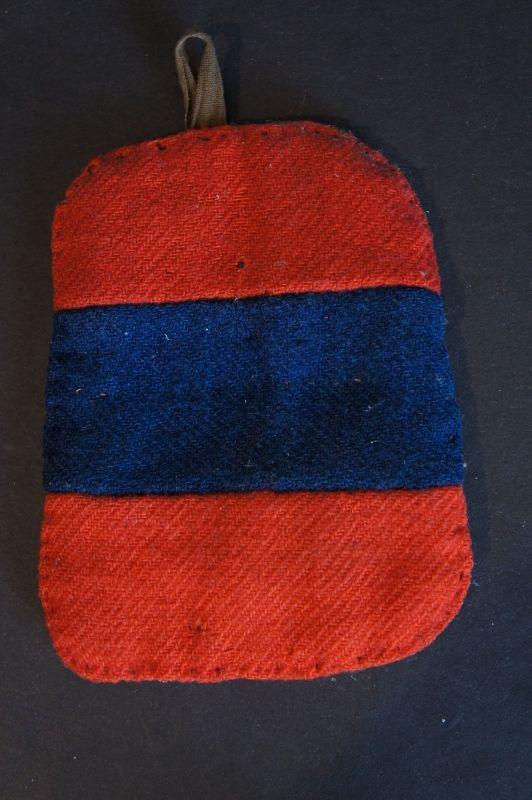 A folky red and blue homespun Pennsylvania potholder Circa 1840