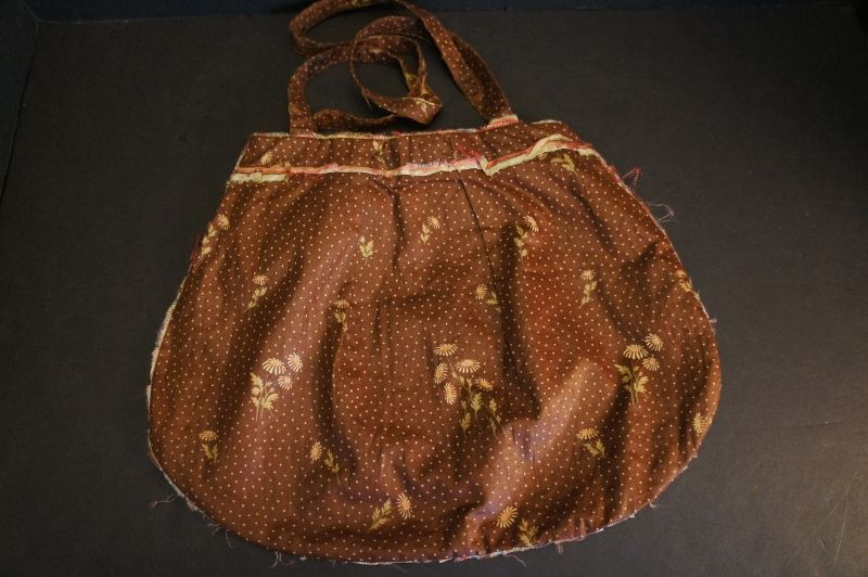 """Brown calico 19th C. bag with a linen lining 10"""" by 13"""""""