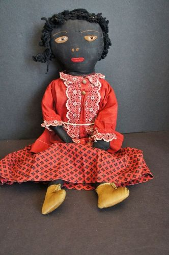 Black doll all hand sewn in red calico skirt  18""