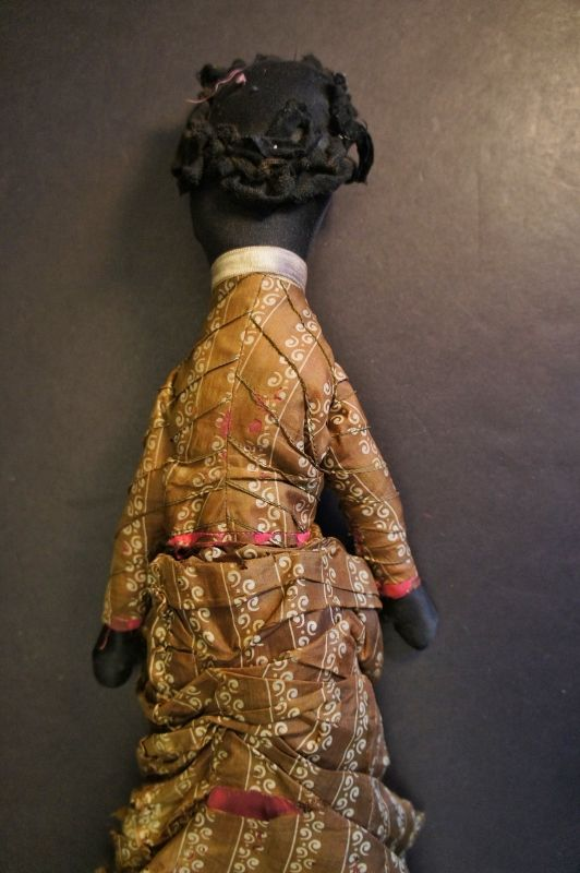 A tall beautiful black woman original clothes,embroidered face 1880