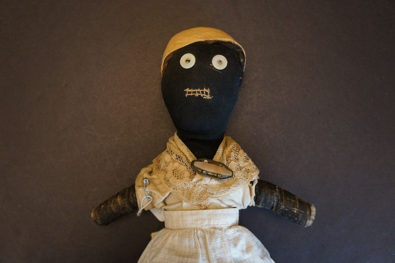 Dear 19th C.little black doll hand sewn great folky face. 17""