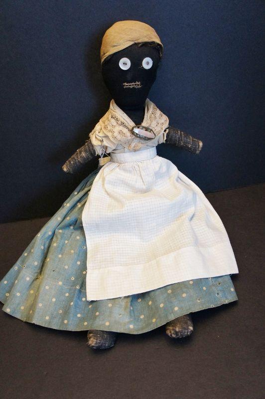 "Dear 19th C.little black doll hand sewn great folky face. 17"""