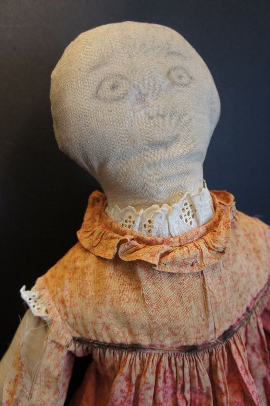 A big pencil face doll looking for a home 25""