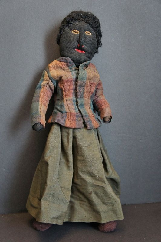 19 C. stocknette black doll, embroidered face, great clothes wire body