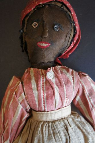 "Interesting heavy black doll with delicate face 16""  Circa 1870-80"