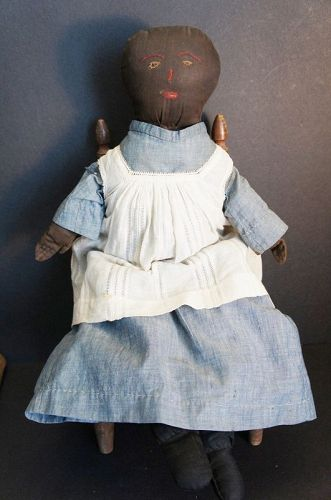 a special black cloth doll with the nicest face with a hint of sadness
