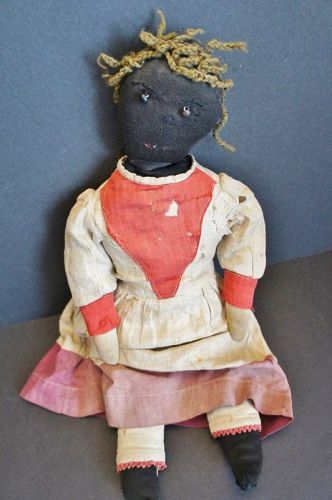 "21""  black doll with shoe button eyes and yarn hair."