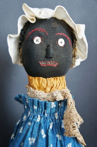 "The best black bottle doll 14""  C.1900"