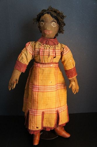 A most unusual black doll with a great face and hair 22""