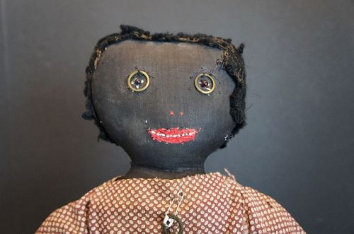 Very folky black doll with curtain ring eyes and a squared off head