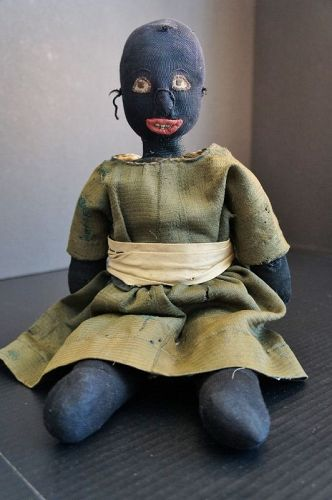 """Little black doll with a lovely a bit shy face. 16"""" and circa 1890"""