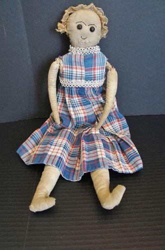 Cute as a bug in a rug, and she is full of fun, cloth doll
