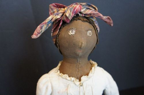Very beautiful black doll with layers of clothes