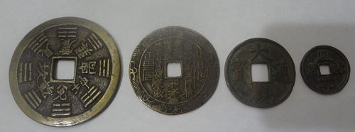 Group of Four Chinese Antique or Vintage Brass Charms