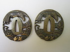 Two bronze tsuba with eagles