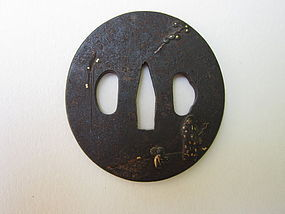 Hiding behind his master's skirt Tsuba