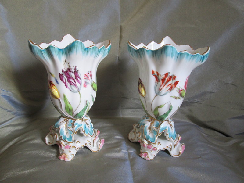 A pair of low floral decorated Coalport porcelain vases