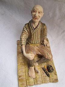 Kyoto Satsuma figure of a reclining man, Meiji period