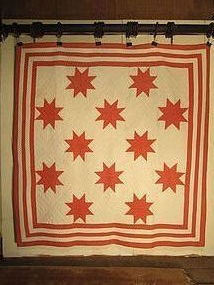 12 star pieced cotton quilt American late 19th century