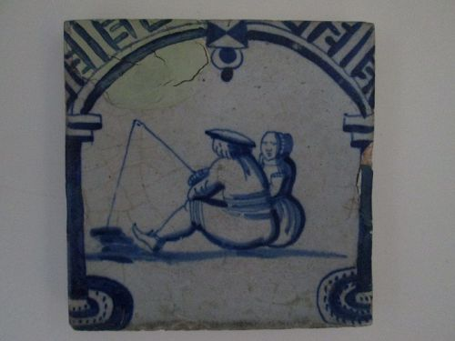 Dutch delft blue and white archway tile c. 1640 of a man with a woman