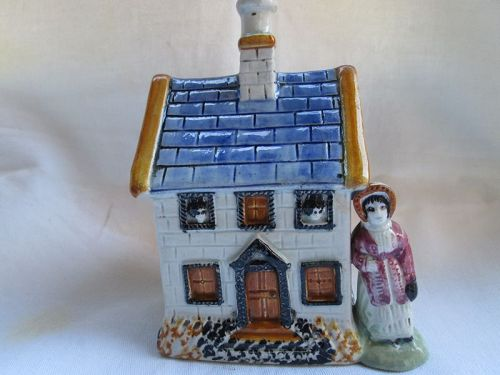 Pratt Ware Cottage money-box with female figure c. 1810