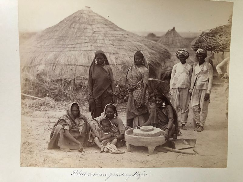 Albumen photo of people outside thatch houses, India c.1880