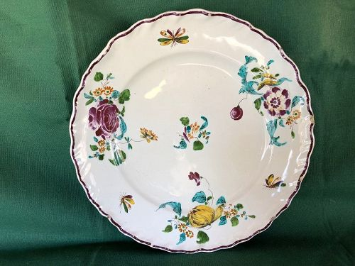 French faience dinner plate with flowers circa 1740, Strasburg?