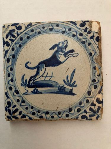 A Dutch Delft tile of a leaping dog circa 1650