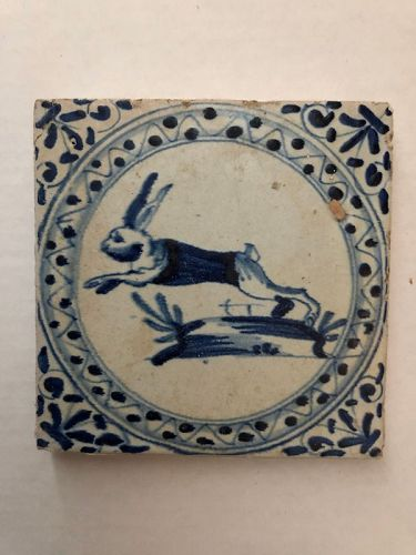 Dutch Delft blue and white wall tile of a running rabbit circa 1650