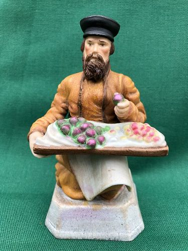 Gardner Russia biscuit porcelain figure kneeling fruit seller c. 1885