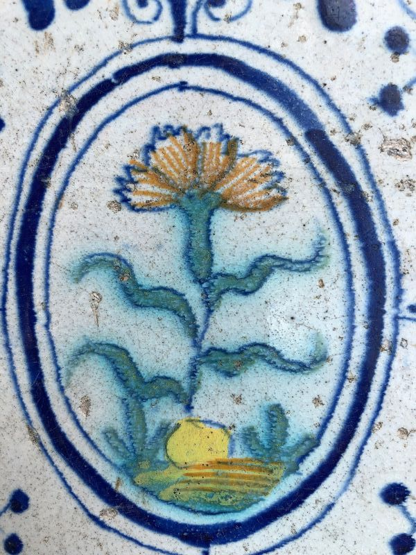 Dutch delft polychrome tile of a carnation 1st half 17th century